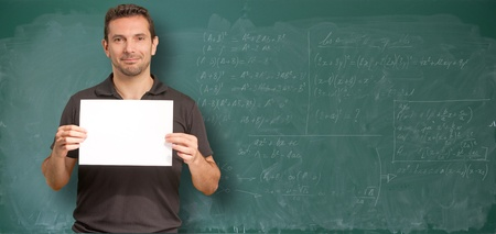 Man by a blackboard with math operations holding a blank sign photo