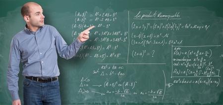 formulae: Friendly maths teacher by the blackboard Stock Photo