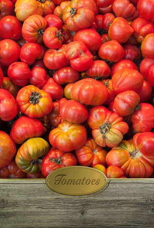 Organic tomatoes framed in wood with a golden label photo