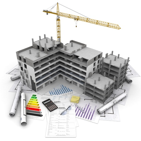 calculations: Building under construction with crane, on top of blueprints, mortgage applications and energy rating Stock Photo
