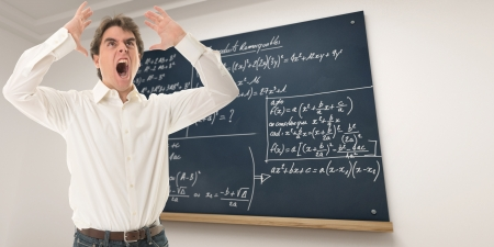 angry teacher: Angry teacher in a mathematics class Stock Photo