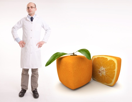 food research: Scientist by a cubic orange