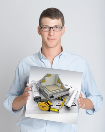 Young man holding a sign with a technical architecture rendering photo