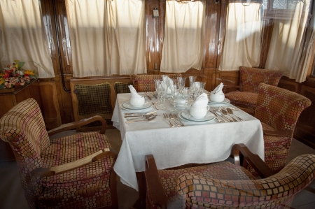 Antique train, restaurant wagon with elegant table