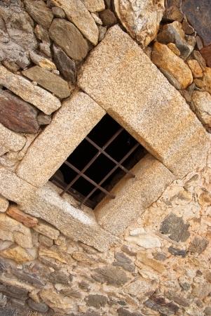iron barred: Iron barred stone window