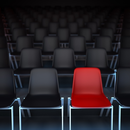 lecture theatre: 3D rendering of rows of black chairs and a red one Stock Photo