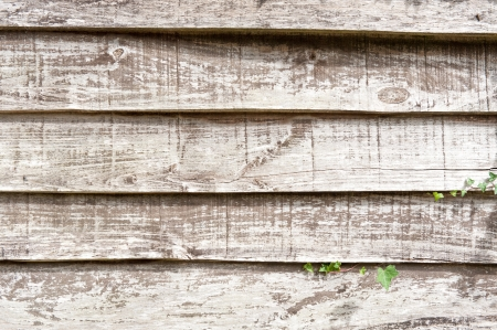 weather beaten: Close up shot on an old wooden wall  Stock Photo