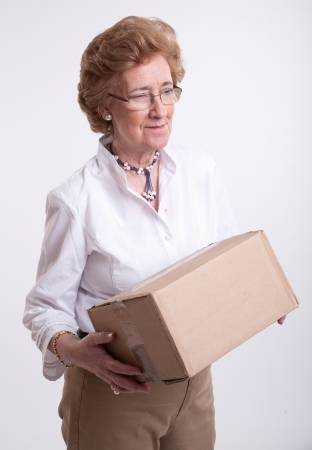 Senior lady holding a brown parcel photo
