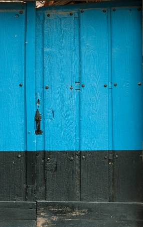 Old wooden door in black and blue paint photo