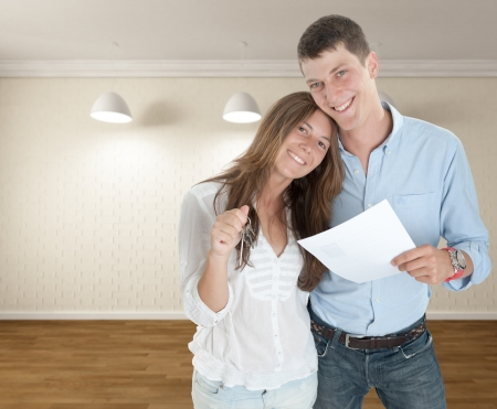 Happy young couple moving in a new home photo
