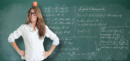 formulae: Young woman with an apple in her head, by a blackboard full of formulae Stock Photo