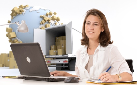 inventories: Friendly woman at her desk  in an international transportation context