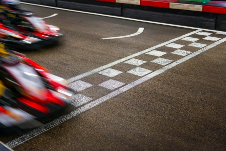 race track: Kart crossing the finish line