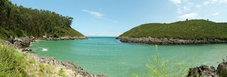 Secluded little bay in Asturias, Spain photo