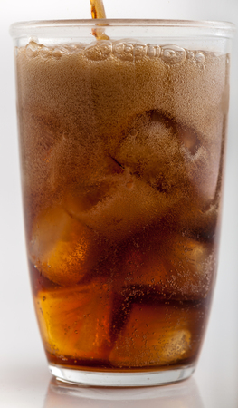 carbonated: A cola drink being poured