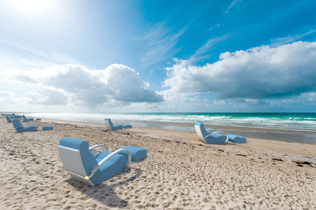 chill out: Relaxing sofas on a beach, facing the sea