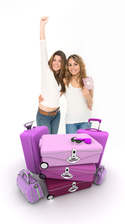 abroad: Two happy female friends with suitcase and passport Stock Photo