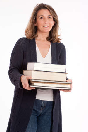 Casual woman holding  a pile of books photo