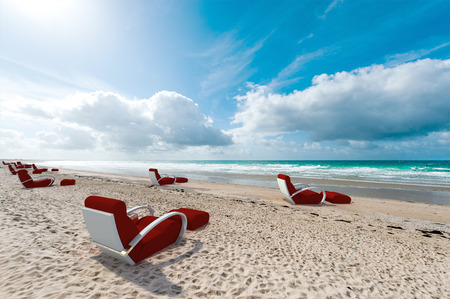 Relaxing sofas on a beach, facing the sea Stock Photo - 22443488