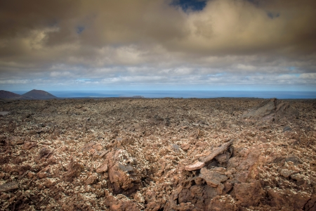 volcanic landscape: Volcanic landscape with the ocean in the background Stock Photo