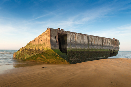 military invasion: Concrete blocks from World War II landing in Gold beach, Normandy Stock Photo