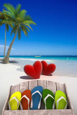 Tropical beach with a pair of hearts and a collection of colorful thongs photo