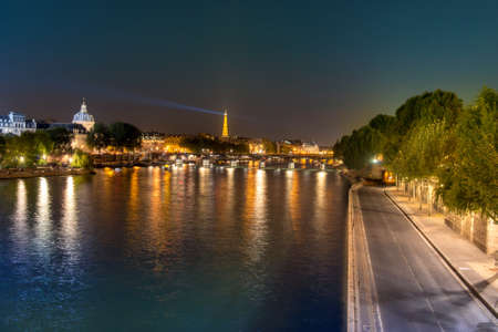 Evening Parisian landscape with a shinning Eiffel Tower photo