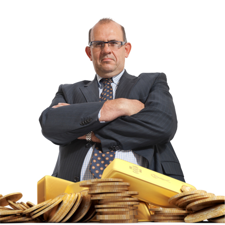 unkind: Angry looking man and a pile of gold