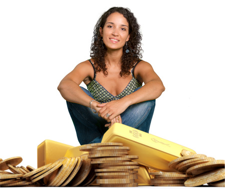 abundance money: Young woman sitting on a pile of gold Stock Photo