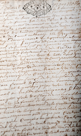 french text:   Old French manuscript from a notary with a stamp