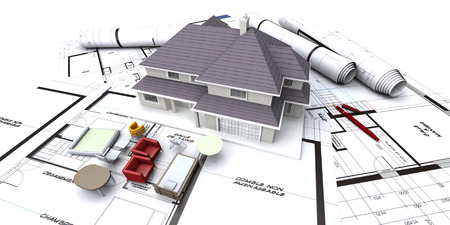 building structures: House mockup on architect's blueprints with rolled-up plans and miniature furniture Stock Photo