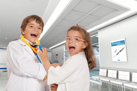 operating room: Little boy and girl playing doctors at the hospital