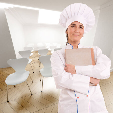female chef:  Female chef with old book in a conference room