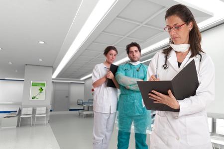 Three healthcare professionals in a hospital interior   photo