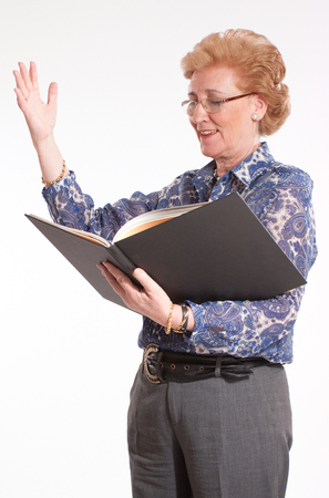 narrator:  Elegant senior lady reading aloud   Stock Photo