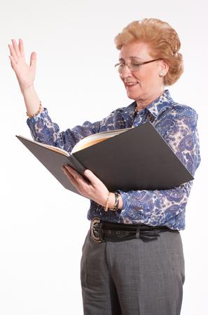 recite:  Elegant senior lady reading aloud   Stock Photo