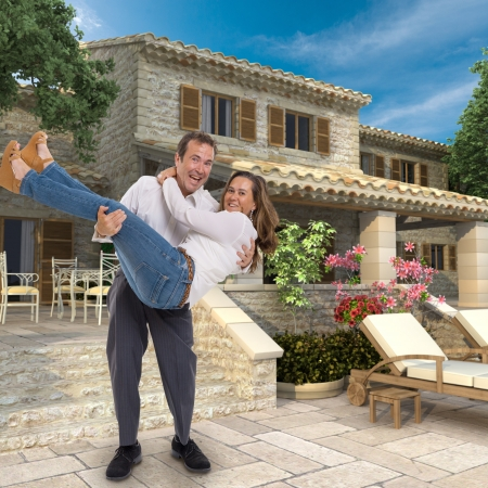 Husband carrying his wife into a magnificent new house photo