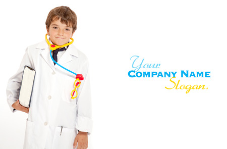Young boy with a doctors uniform and toy instruments  photo