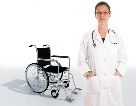discharges:   Serious female doctor with a wheelchair on the background   Stock Photo