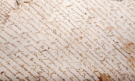 old writing:   Close-up shot on an old manuscript written in French   Stock Photo