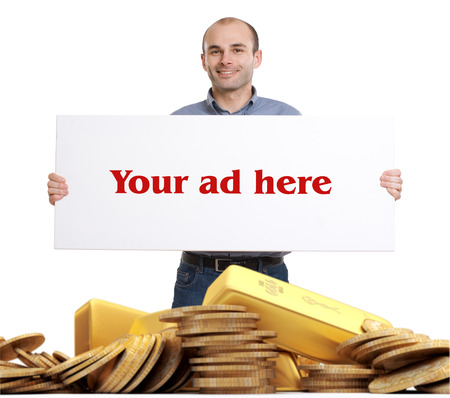 Man holding a blank sign standing on a pile of gold photo