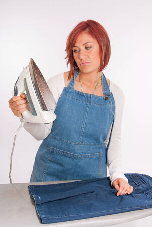 Woman looking with disgust at her iron   photo