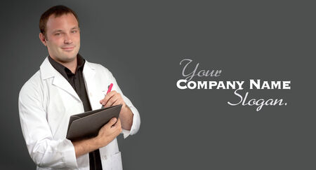 medical notes: Young man with a medical uniform taking notes Stock Photo