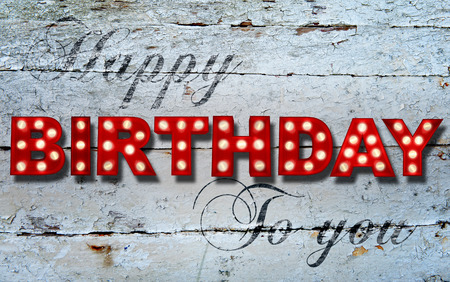 imperfection: Shabby chic wooden background with glowing letters writing Happy Birthday to you Stock Photo