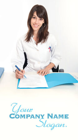 admissions:   Smiling young woman in a lab coat sitting at the desk  with an open folder
