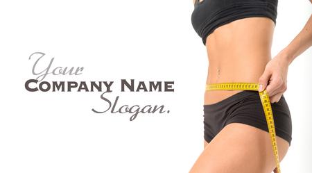 Woman measuring her thin waist