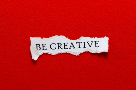 motto: A scrap of paper with the motto, be creative