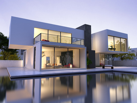residential: External view of a modern house with pool at dusk