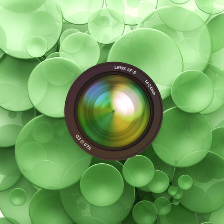 Green disks and a camera lens Stock Photo - 27045300