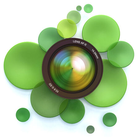 Green disks and a camera lens Stock Photo - 27102874